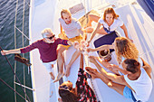 Friends toasting champagne on sunny boat