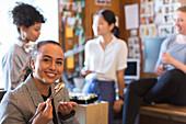 Portrait creative businesswoman eating sushi