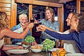 Friends enjoying dinner in cabin