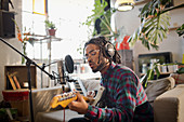 Musician recording music in apartment