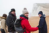 Portrait family on snowy winter beach