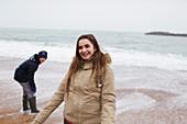 Smiling teenage girl on winter ocean beach