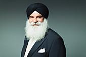 Portrait well-dressed senior man wearing turban