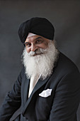 Portrait senior man with beard in turban