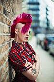 Confident young woman with pink mohawk