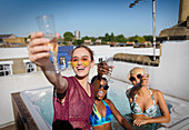 Portrait confident, carefree friends drinking champagne