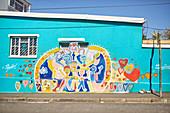 Vibrant community mural on urban wall