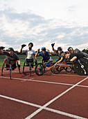 Paraplegic athletes cheering