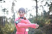 Female runner adjusting mp3 player armband