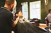 Man receiving a shave in barbershop