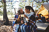 Happy lesbian couple relaxing, drinking coffee