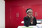 Portrait female community college student in classroom