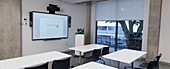 Empty classroom with projection screen