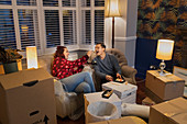 Couple taking a break from moving, eating sushi