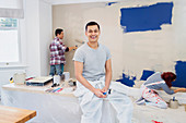 Portrait happy man painting with friends