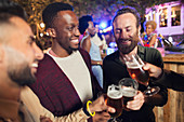 Male friends drinking beers at garden party
