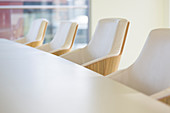 White leather armchairs in a row in conference room
