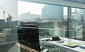 Sunny, urban highrise office