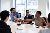 Business people shaking hands in conference room meeting