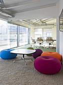 Multicolour cushions in creative office space