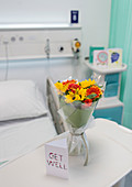 Flower bouquet and Get Well card on tray