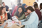 College students studying together in classroom