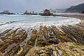 Tranquil rocky ocean beach Gueira Beach Asturias Spain