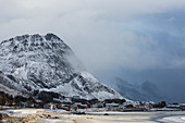 Snow covered mountain above remote village