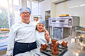 Portrait happy students with Down Syndrome in baking class