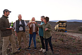 Happy safari tour group drinking champagne