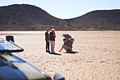 Guide and group in sunny arid landscape South Africa
