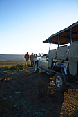 Group and off-road vehicle on hill South Africa