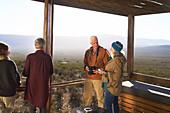 Senior couple on sunny safari lodge balcony