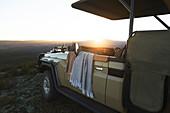 Sunrise behind safari off-road vehicle South Africa
