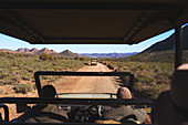 Guide drive off-road vehicle sunny dirt road South Africa