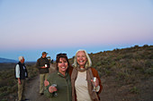 Mature women friends on safari drinking champagne