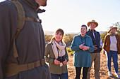 Safari tourists listening to tour guide