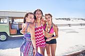Portrait carefree women friends on sunny summer beach