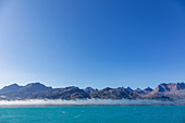 Blue sky over majestic mountain landscape and ocean