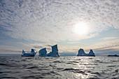 Majestic icebergs below sky on Atlantic Ocean Greenland