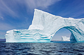 Majestic iceberg arch over Atlantic Ocean Greenland