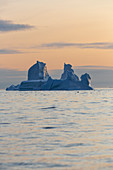 Majestic iceberg formation on Atlantic Ocean at sunset