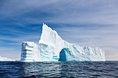Majestic iceberg with arch
