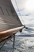 Sailboat mast over ocean