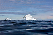 Majestic iceberg formations over blue ocean