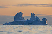 Tranquil majestic iceberg on sunset