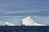 Majestic iceberg formations on blue