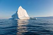 Majestic iceberg on tranquil blue Atlantic Ocean Greenland