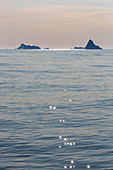 Icebergs in distant on idyllic Atlantic Ocean Greenland