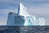 Majestic towering iceberg on blue Atlantic Ocean Greenland